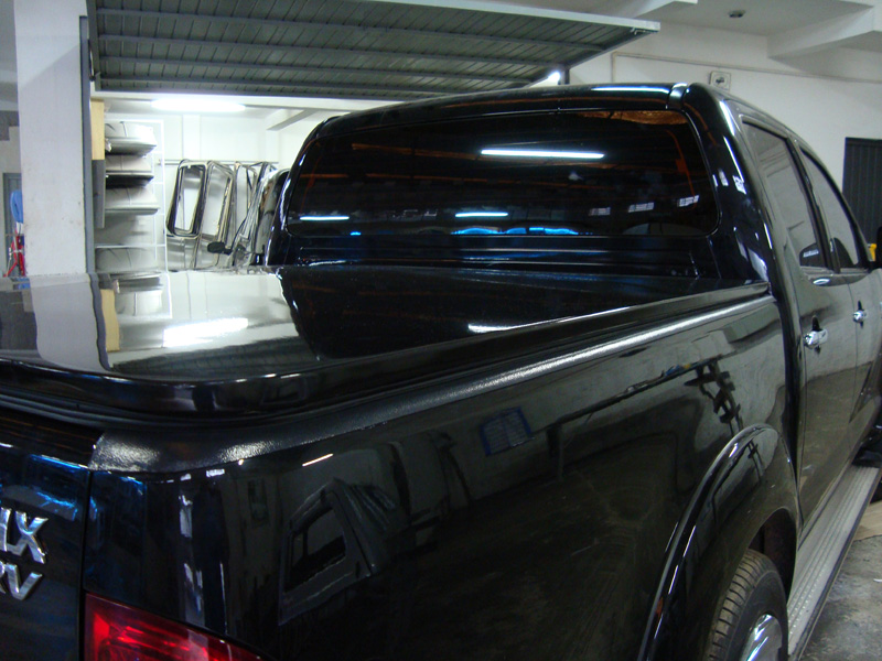 Tampão baixo elétrico em chapa de aço para Toyota Hilux com pintura na cor do veiculo, tampão marítimo Hilux.